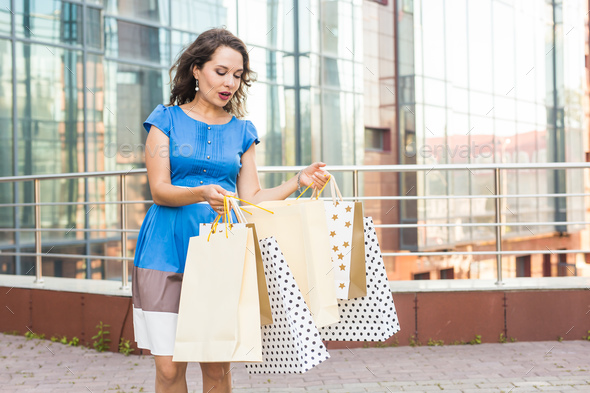 Shopper. Shopaholic shopping woman holding many shopping bags excited. Addiction concept - Stock Photo - Images