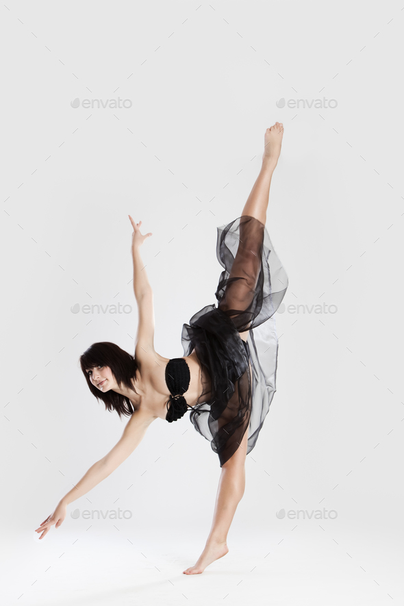 Beautiful female ballerina doing split - Stock Photo - Images