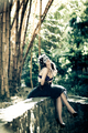 Woman in bra and heels sitting under bamboos - PhotoDune Item for Sale
