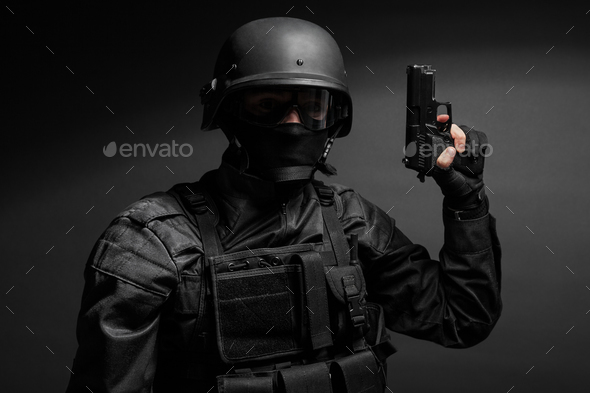 SWAT police officer with pistol - Stock Photo - Images