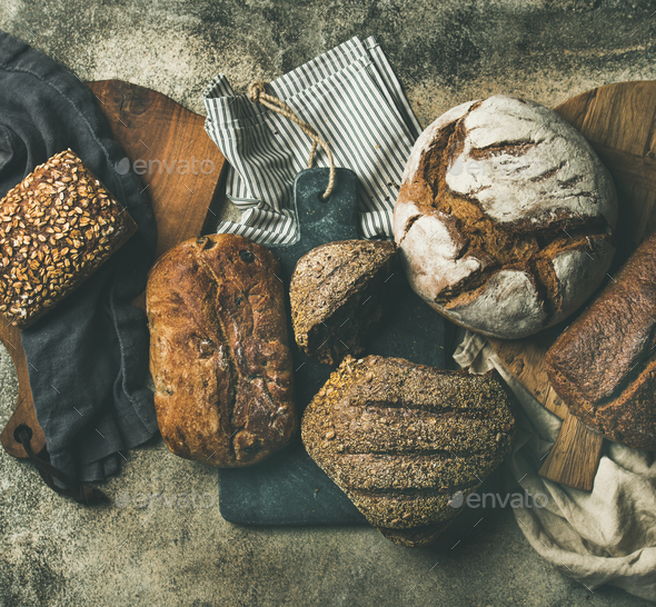 Flat-lay of various bread loaves, top view - Stock Photo - Images