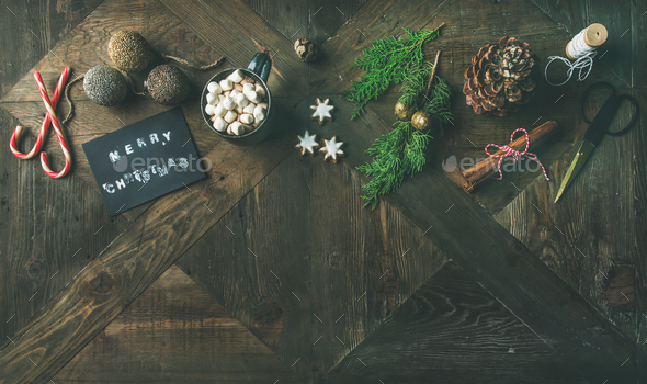 Flat-lay of greeting card, glittering toys, hot chocolate, cinnamon, scissors - Stock Photo - Images