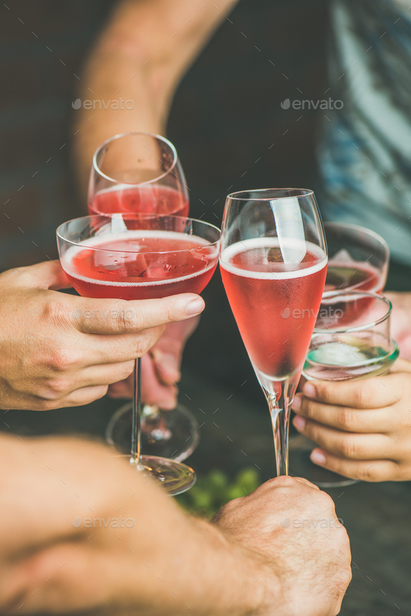 People having party, gathering, celebrating with rose champaign, vertical composition - Stock Photo - Images