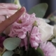 The Bride Is Holding a Wedding Bouquet in Her Hands, Fingering the Flowers - VideoHive Item for Sale