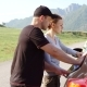 Happy Young Couple with a Map in the Car. They Are Using Map on Road Trip - VideoHive Item for Sale