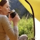 Girl Is Drinking Tea From a Mug of Thermos on the Background of Mountains - VideoHive Item for Sale