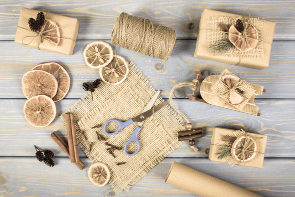 Aged photo, Accessories, decoration and wrapped gifts for Christmas with wooden sled on old boards - Stock Photo - Images