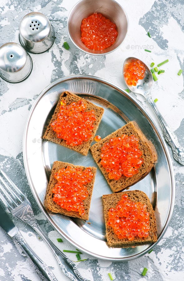 bread with red salmon caviar - Stock Photo - Images