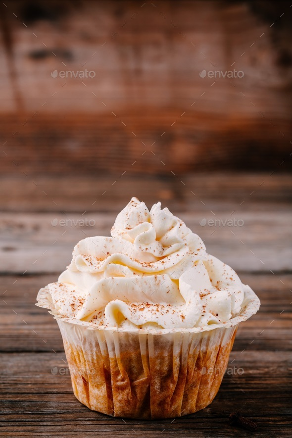 Pumpkin cupcakes decorated with cream cheese frosting - Stock Photo - Images