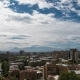 of Clouds Above the City with Huge Mountain Behind - VideoHive Item for Sale