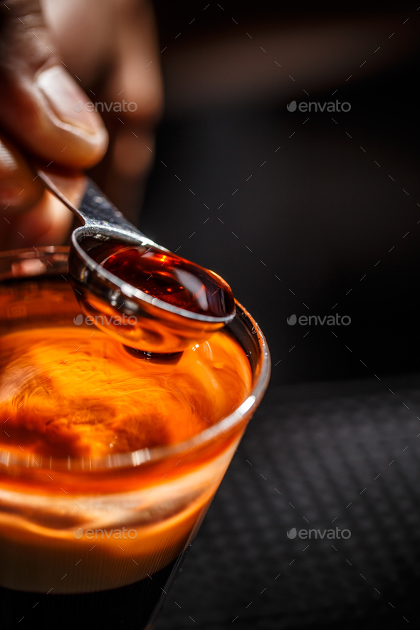 Barman hand pouring alcohol - Stock Photo - Images