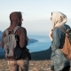 Two Young Women Tourist with Backpack Walking at Rock of Mountains with Beautiful Nature Landscape - VideoHive Item for Sale