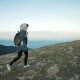 Woman Hiker Walking on Mountain Terrain Wearing Backpack - VideoHive Item for Sale
