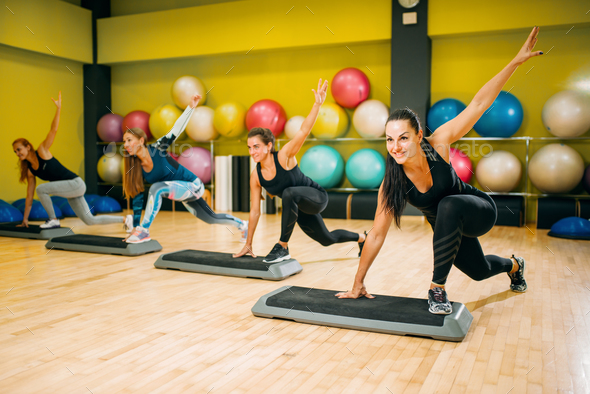 Athletic women on step aerobic workout indoor - Stock Photo - Images