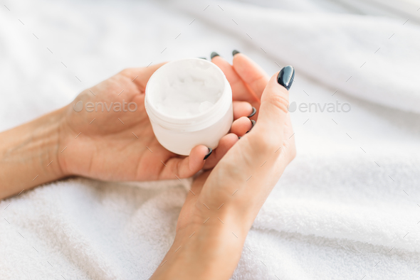 Female hands with cosmetic cream closeup, skincare - Stock Photo - Images