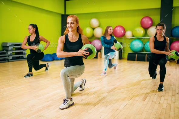 Women group with balls in motion, fitness workout - Stock Photo - Images