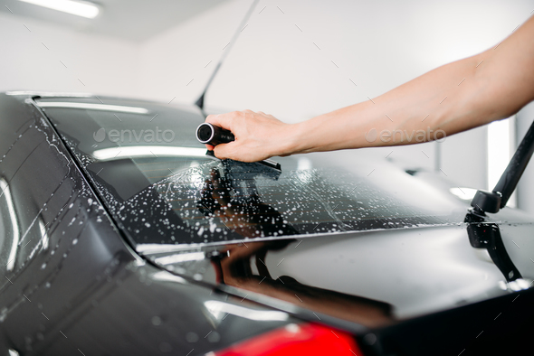 Specialist work, car tinting film installation - Stock Photo - Images