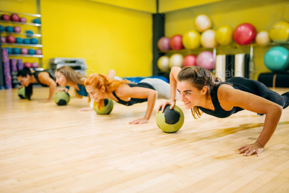 Women group with balls doing push up exercise - Stock Photo - Images