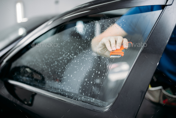 Specialist work with car, tinting film installing - Stock Photo - Images