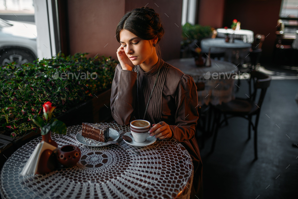 Woman eating delicious chocolate cake in cafe - Stock Photo - Images