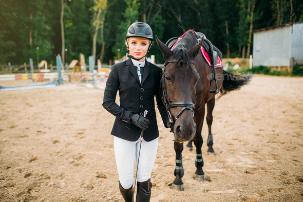Equestrian sport, female jockey and horse - Stock Photo - Images
