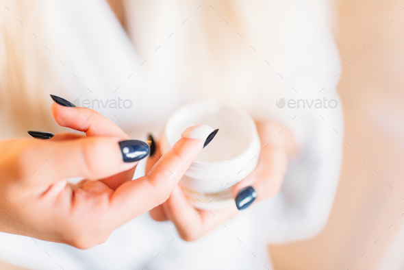 Smiling female person in bathrobe, skincare - Stock Photo - Images