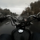 Biker Motorcycle Chopper Rides on the Wet Asphalt in the City - VideoHive Item for Sale