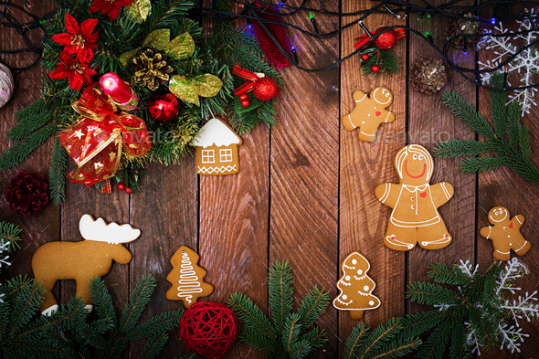 Christmas cookies and tinsel on a dark wooden background. Top view. Flat lay - Stock Photo - Images