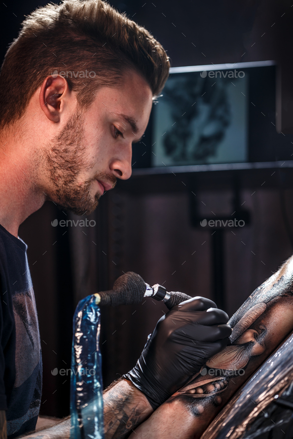 Professional tattoo artist - Stock Photo - Images