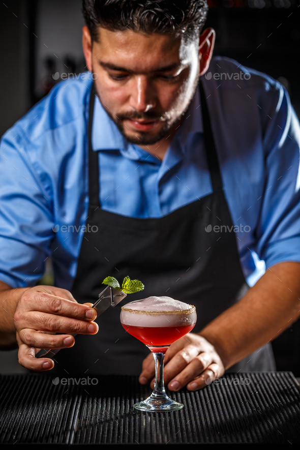 Bartender is decorating cocktail - Stock Photo - Images