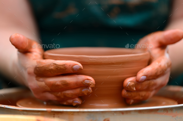 Potter making ceramic pot on the pottery wheel - Stock Photo - Images