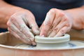 Potter making ceramic pot on the pottery wheel - PhotoDune Item for Sale