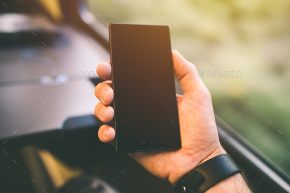 Hand with mobile phone on train - Stock Photo - Images