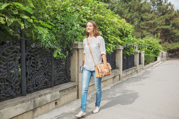 Pretty girl is walking in the city - Stock Photo - Images
