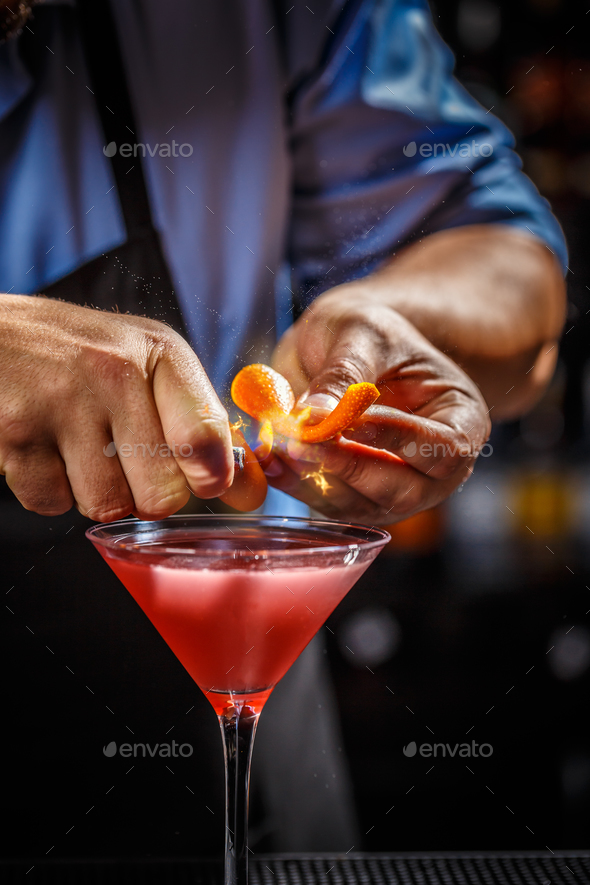 Barman is decorating cosmopolitan cocktail - Stock Photo - Images
