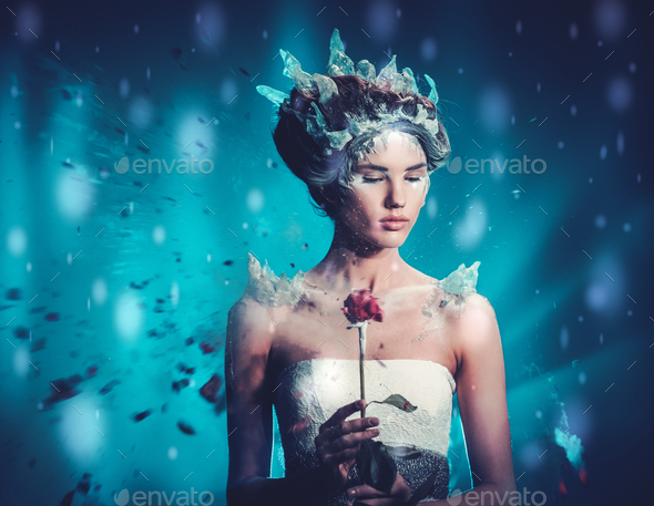 Beautiful ice queen in a falling snow - Stock Photo - Images