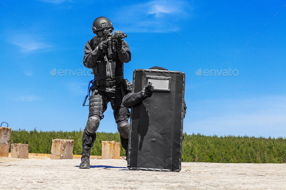 police storming criminals terrorists - Stock Photo - Images