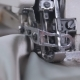 A Woman Using a Sewing Machine To Sew Fabric Together - VideoHive Item for Sale