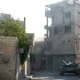 Damascus, Syria, September 2013: The Tank Stands Near a Smoking Building After the Fighting of the - VideoHive Item for Sale