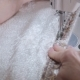 Footage of a Woman Sewing a White Cotton with a Sewing Machine - VideoHive Item for Sale