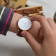 Girl's hand with wrist watches at the coffee break - PhotoDune Item for Sale