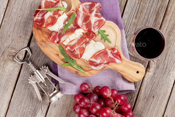 Prosciutto and mozzarella with red wine - Stock Photo - Images