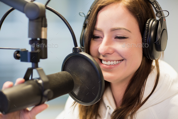 Jockey Smiling While Using Headphones And Microphone In Radio St - Stock Photo - Images