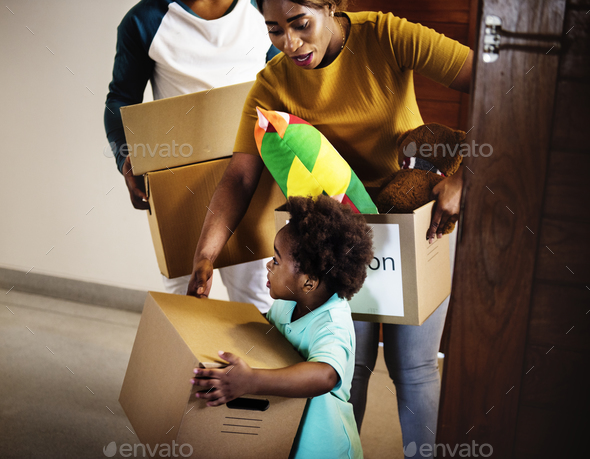 Black family moving in to new house - Stock Photo - Images