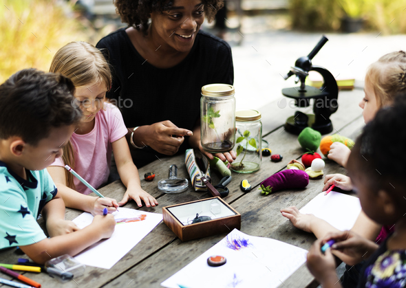 Group of kids classmates learning biology drawing class - Stock Photo - Images
