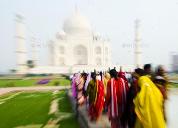 People walking through the Taj Mahal. - Stock Photo - Images