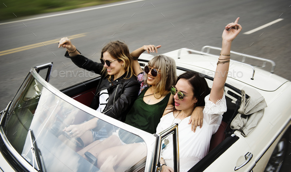 Diverse group of people enjoying a road trip and festival - Stock Photo - Images