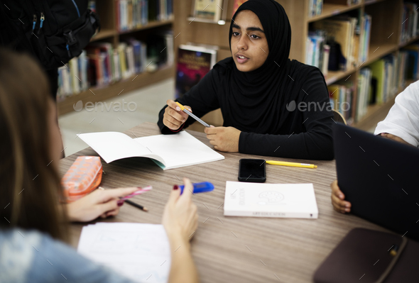 A group of students working in the library - Stock Photo - Images