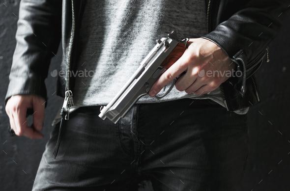 Man holding a gun - Stock Photo - Images