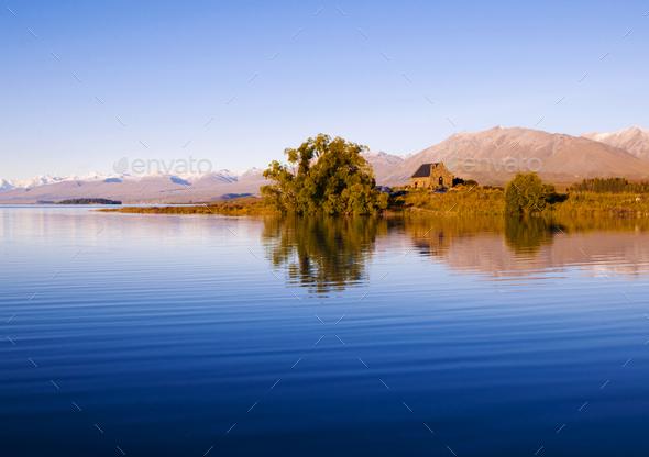 Church of the Good Shepherd and Lake, Mackenzie Country, Canterbury, New Zealand. - Stock Photo - Images